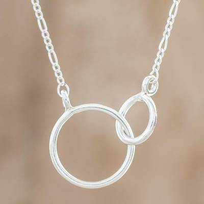 Sterling silver pendant necklace, 'Connected Rings\ - Circular Sterling Silver Pendant Necklace from Guatemala
