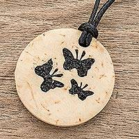 Coconut shell and lava stone pendant necklace, 'Three Butterflies' - Coconut Shell and Lava Stone Butterfly Pendant Necklace