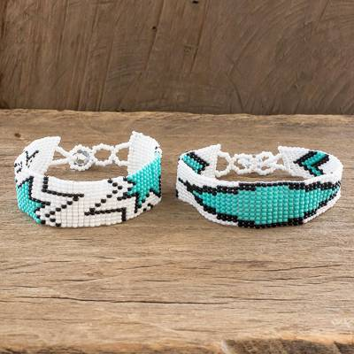 Beaded wristband friendship bracelets, 'Banner and Star' (pair) - Turquoise and White Beaded Friendship Bracelets (Pair)