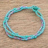 Glass bead bracelet, 'Lines in Turquoise' - Glass Bead Strand Bracelet in Aqua and Lilac from Guatemala