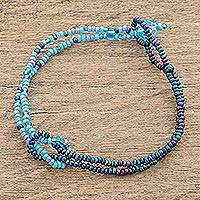 Glass beaded bracelet, 'Divine Union in Blue' - Glass Beaded Knotted Bracelet from Guatemala