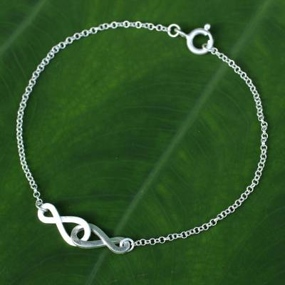 Sterling silver pendant bracelet, 'Into Infinity' - Linked Infinity Symbol Bracelet in Brushed Sterling Silver