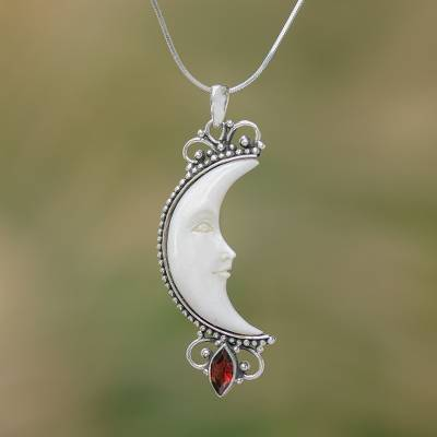 Garnet and bone pendant necklace, 'Moonlight Glimmer' - Garnet and Bone Crescent Moon Pendant Necklace from Bali