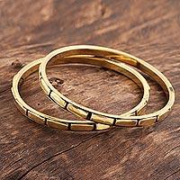 Brass bangle bracelets, 'Delightful Procession' (pair) - Patterned Brass Bangle Bracelets from India (Pair)