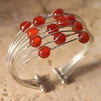 Carnelian bracelet, 'Encounter' - Hand Crafted Carnelian Cuff Bracelet