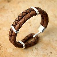 Men's leather bracelet, 'Provocative' - Men's Braided Leather Wrist Band with Sterling Silver