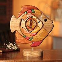 Cedar and mahogany sculpture, 'Fish Family' - Playful Wood Fish Statuette Folk Art Hand Carved in Peru