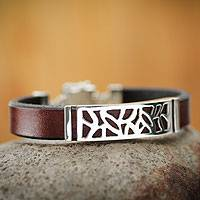 Men's leather bracelet, 'Evolution' - Peruvian Handcrafted Sterling Silver and Leather Bracelet