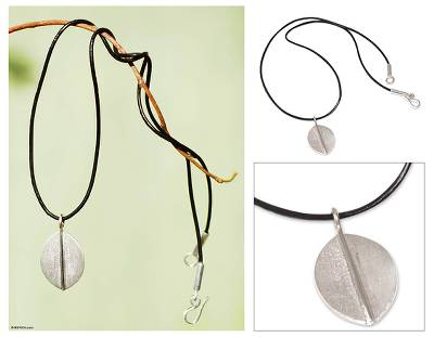 Sterling silver pendant necklace, 'Lucky Leaf' - Peruvian Leaf Sterling Silver Leather Cord Pendant Necklace