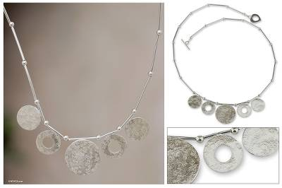 Sterling silver pendant necklace, 'Hypnotic Circles' - Sterling silver pendant necklace