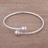 Sterling silver wrap bracelet, 'Irresistible' - Peruvian Sterling Silver Modern Wrap Bracelet