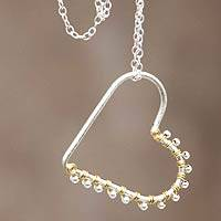 Gold accent sterling silver pendant necklace, 'Buoyant Heart' - Hand Crafted Sterling Necklace 18k Gold Plated Heart Pendant