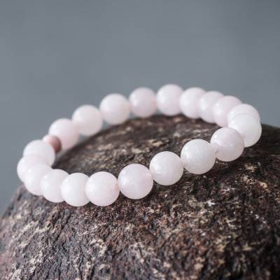 Rose quartz and ceramic stretch bracelet, 'Pink Whisper' - Handmade Pink Rose Quartz Stretch Bracelet from Peru