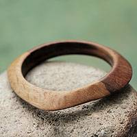 Wood bangle bracelet, 'Forest Sigh' - Artisan Crafted Asymmetrical Wood Bangle Bracelet from Peru