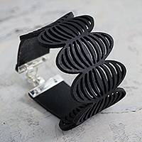 Leather wristband bracelet, 'Black Infinity' - Artisan Crafted Modern Leather Wristband Bracelet