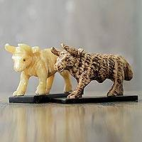 Aragonite figurines, 'Bull Friends' (pair) - Yellow and Brown Aragonite Bull Figurines on Onyx (Pair)