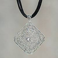 Sterling silver flower necklace, 'Sumak' - Sterling Silver Square Pendant on Black Cotton Cord Necklace