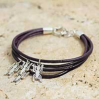 Sterling silver and leather charm bracelet, 'Nazca Spiders' - Handmade Burgundy Leather Bracelet with Silver Nazca Charms