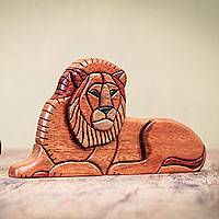 Cedar and mahogany sculpture, 'Lion at Rest'