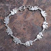 Sterling silver link bracelet, 'Elephant Dignity' - Artisan Crafted Sterling Silver Bracelet with Elephant Links