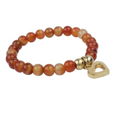 Gold plated carnelian beaded bracelet, 'My Heart of Gold' - Carnelian Beaded Bracelet with Shiny Golden Heart Charm