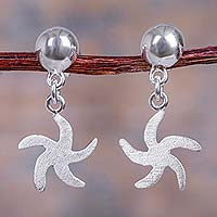 Sterling silver dangle earrings, 'Starfish Spin' - Handcrafted Sterling Silver Starfish Dangle Earrings