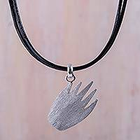 Sterling silver pendant necklace, 'Gentle Hand' - Sterling Silver Necklace with Black Leather Cords