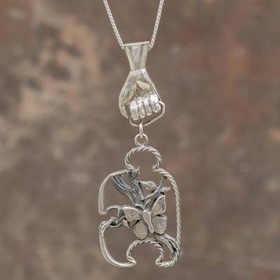 Sterling silver pendant necklace, 'God's Hand in Eden' - Handcrafted Creation Theme Sterling Silver Pendant Necklace