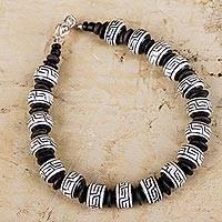 Ceramic beaded bracelet, 'Inca Message' - Handcrafted Ceramic Black and White Inca Style Bracelet