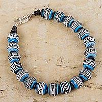 Ceramic beaded bracelet, 'Blue Inca Message' - Artisanal Blue Ceramic Bracelet with Black and White Glyphs