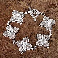 Sterling silver filigree link bracelet, 'Lavish Blossoms' - 925 Sterling Silver Bracelet with Filigree Flower Links