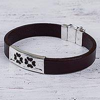 Sterling silver and leather wristband bracelet, 'Twin Clovers' - Sterling Silver and Leather Wristband Bracelet from Peru