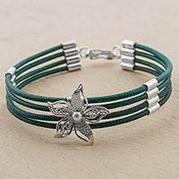 Sterling silver and leather pendant bracelet, 'Amaryllis Flower in Green' - Sterling Silver and Green Leather Flower Pendant Bracelet