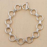 Silver link bracelet, 'Unity Circle' - Artisan Crafted Silver Link Bracelet with Circular Motif