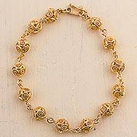 Gold plated sterling silver filigree link bracelet, 'Little Worlds'