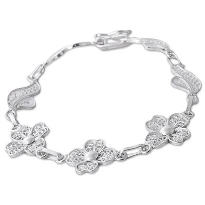 Sterling silver filigree link bracelet, 'Sparkling Flowers' - Sterling Silver Filigree Floral Link Bracelet from Peru