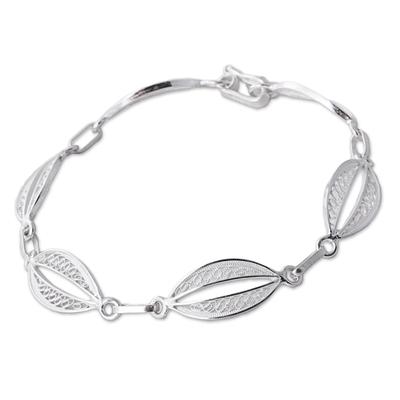 Sterling silver filigree link bracelet, 'Sparkling Crescents' - 925 Sterling Silver Filigree Oval Link Bracelet from Peru
