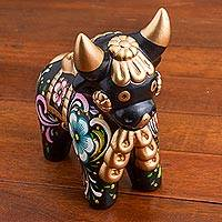 Ceramic figurine, 'Colorful Pucara Bull' - Black Painted Ceramic Bull with Flower Motifs from Peru