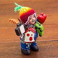 Ceramic figurine, 'Joyful Ekeko in Blue' - Hand Painted Floral Ekeko Figurine with Wool Cap from Peru