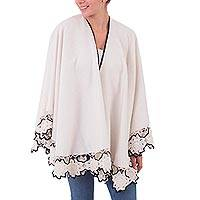 Alpaca blend cape, 'Florid Snowflakes' - Off White Alpaca Blend Cape with Black Trim Floral Fringe