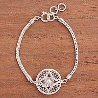 Sterling silver filigree pendant bracelet, 'Elegant Beauty' - Hypnotic Filigree Pendant on Sterling Silver Bracelet