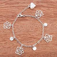 Sterling silver charm bracelet, 'Forever Beautiful' - 925 Sterling Silver Charm Bracelet by Peruvian Artisans
