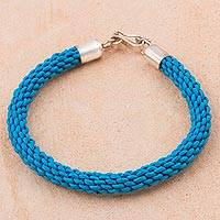 Leather wristband bracelet, 'Braided Andes in Blue' - Blue Leather Braided Wristband Bracelet by Peruvian Artisans