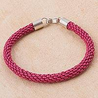 Leather wristband bracelet, 'Braided Andes in Pink' - Pink Leather Braided Wristband Bracelet by Peruvian Artisans