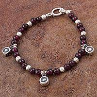 Garnet beaded bracelet, 'Dramatic Crimson' - Garnet and 925 Sterling Silver Beaded Bracelet from Peru