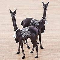 Silver accented cedar sculptures, 'Sun and Moon Llamas' - Pair of Silver Accent Cedar Llama Sculptures from Peru