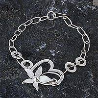 Sterling silver pendant bracelet, 'Flowering Rapture' - Sterling Silver Floral Heart Pendant Bracelet from Peru