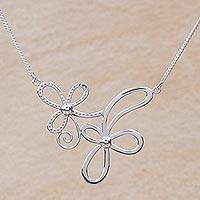 Sterling silver pendant necklace, 'Blossoming Ribbons' - Peruvian Sterling Silver Necklace with Modern Floral Design