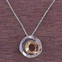 Gold accent sterling silver pendant necklace, 'Alignment Eclipse' - Gold Accent Sterling Silver Pendant Necklace from Peru