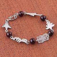 Garnet link bracelet, 'The Mysteries of Nazca' - Garnet and Fine Silver Bracelet with Nazca Shapes from Peru